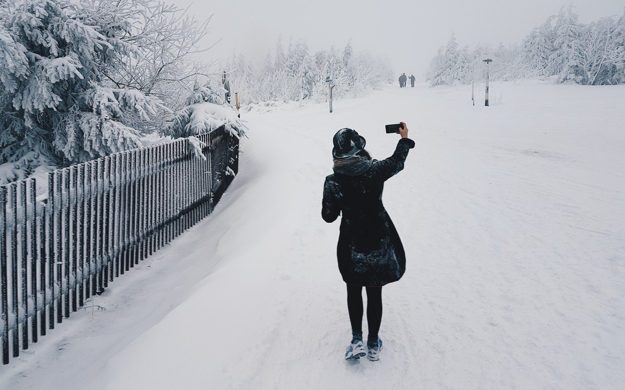 Taking a photo in the snow.